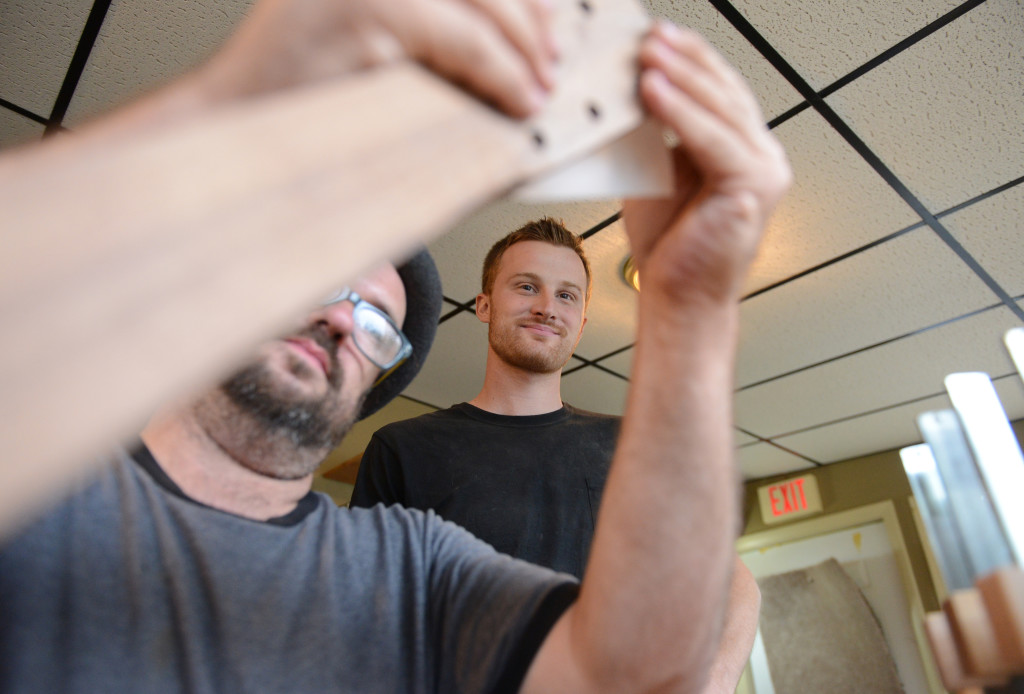 Eric Schaefer teaches a week-long guitar making course at his workshop in Bernville. Aaron Cromie, Philadelphia, tests out the drawing of his inlay on his guitar as Eric Schaefer looks on. Photo by Susan L. Angstadt 6/18/2015